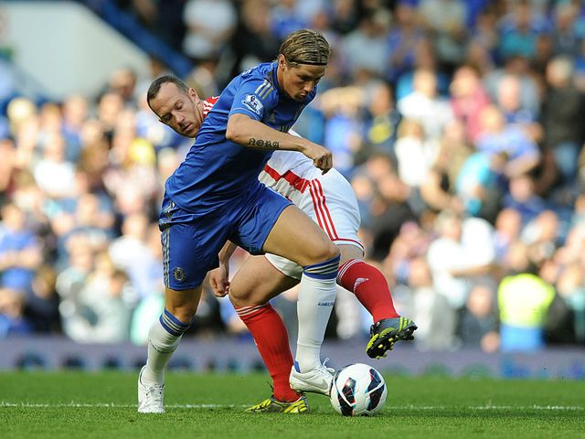 Fernando Torres tries to get clear of Charlie Adam