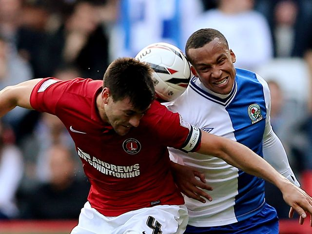 Johnnie Jackson and Martin Olsson battle for the ball