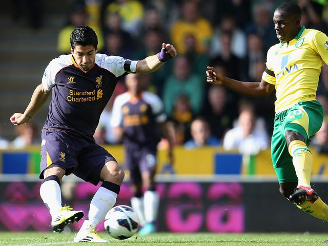 Luis Suarez fires Liverpool into an early lead