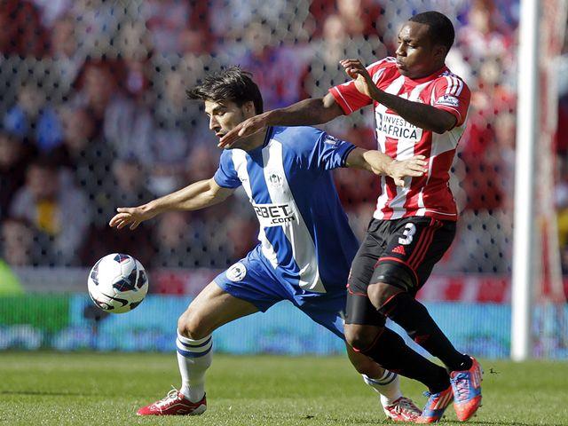 Jordi Gomez holds off Danny Rose