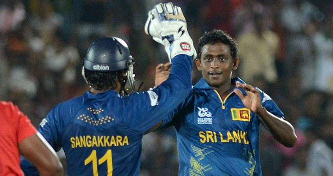 Immediate impact: Mendis celebrates the wicket of Zimbabwe's Hamilton Masakadza