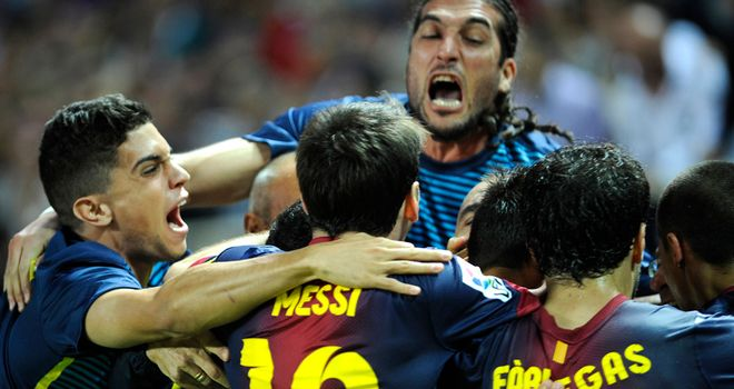 Barcelona celebrate their winner.
