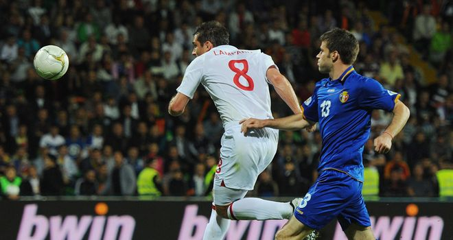 Frank Lampard: Heads home his and England's second goal to make it an easy night in Moldova