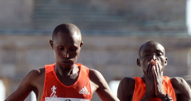 Geoffrey Mutai: Berlin winner (left) survived a brave challenge from Dennis Kimetto