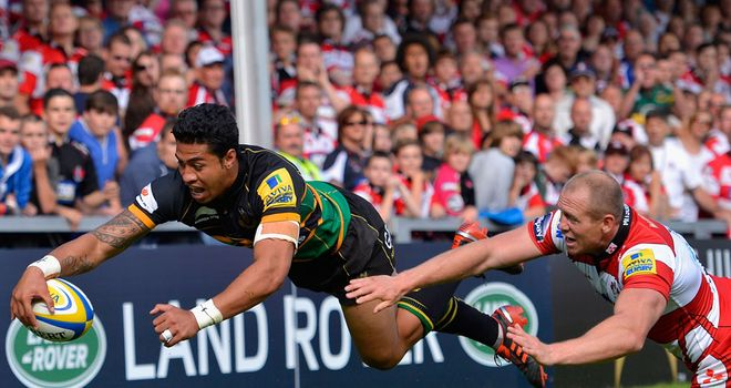 George Pisi: squeezes over in the corner for one of his two tries