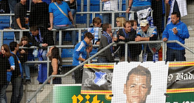Hoffenheim fans show support for Boris Vukcevic, who remains in hospital