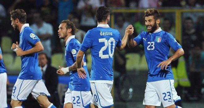Italy celebrate victory in Modena.