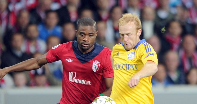 Aurelien Chedjou (l): His own goal gave PSG the win over Lille
