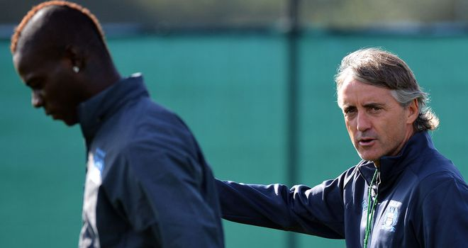 Roberto Mancini: Has offered an olive branch to errant striker Mario Balotelli