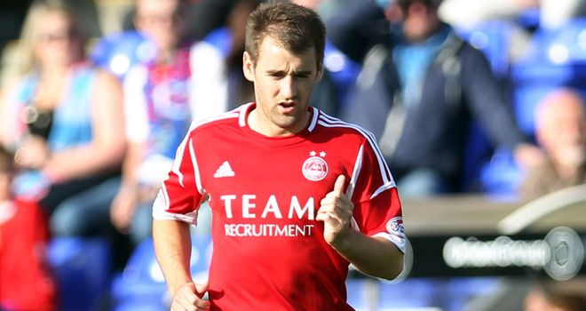 Niall McGinn: Club record for Dons