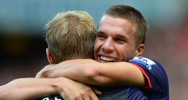 Lukas Podolski: Scores first Arsenal goal against Liverpool following a pass by Santi Cazorla