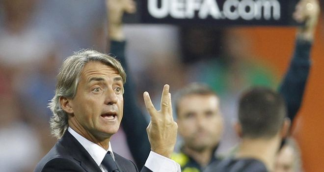 Roberto Mancini: Experimenting with a back-three formation at Manchester City