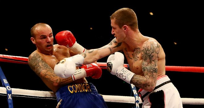 Ricky Burns drives Kevin Mitchell back onto the ropes