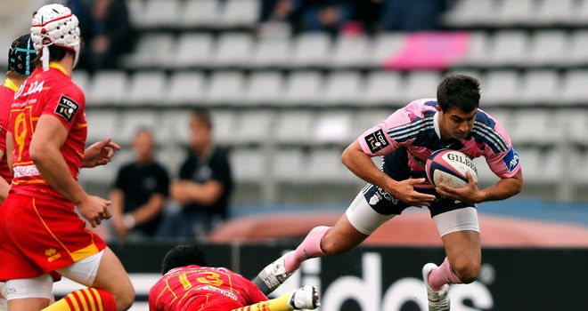 Stade Francais hero Jerome Porical is tackled by Perpignan's Lifeimi Mafi