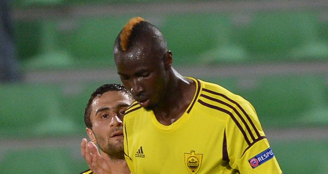 Lacina Traore celebrates his goal for Anzhi