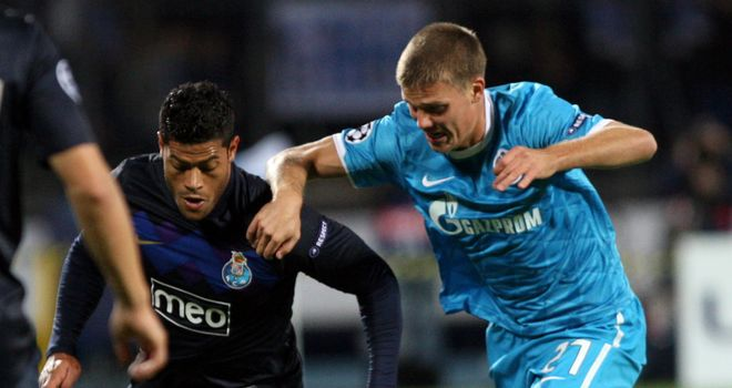 Hulk (l) and Igor Denisov (r) going head to head in last season's Champions League