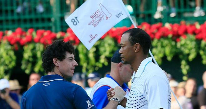 Tiger Woods (R) has enjoyed the opportunity to play with Rory McIlroy (L) on a regular basis recently