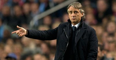 Roberto Mancini: Unconcerned over speculation linking Guardiola with City job
