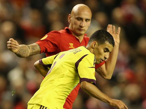 Mbark Boussoufa competes with Jonjo Shelvey