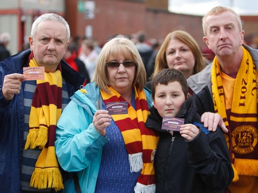 Motherwell fans with their match abandoned vouchers.