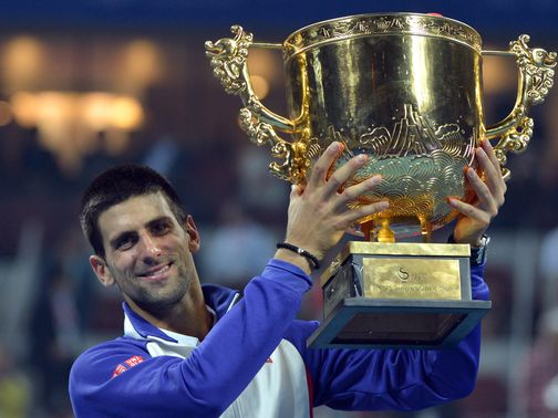 Novak Djokovic with the spoils of victory