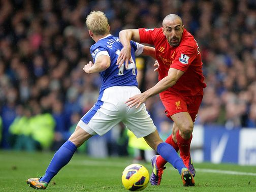 Steven Naismith can't stop Jose Enrique.