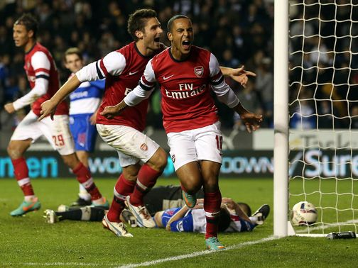 Arsenal celebrate during their incredible win at Reading