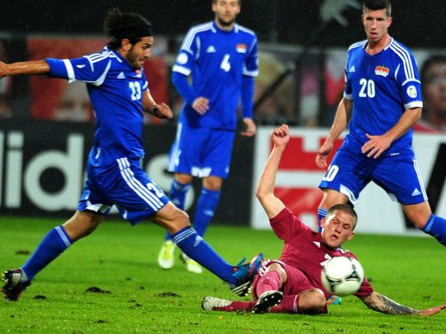 Vladimirs Kamess slides in for a tackle