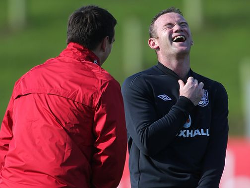 Wayne Rooney shares a joke with Gary Neville