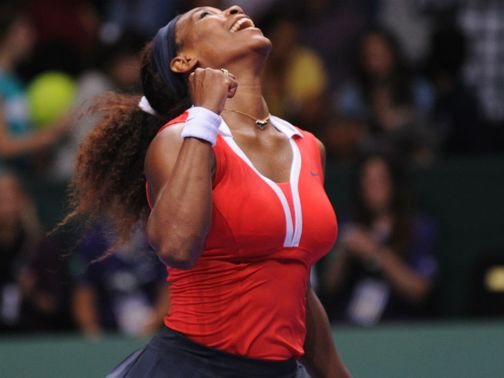Serena Williams celebrates her victory over Maria Sharapova