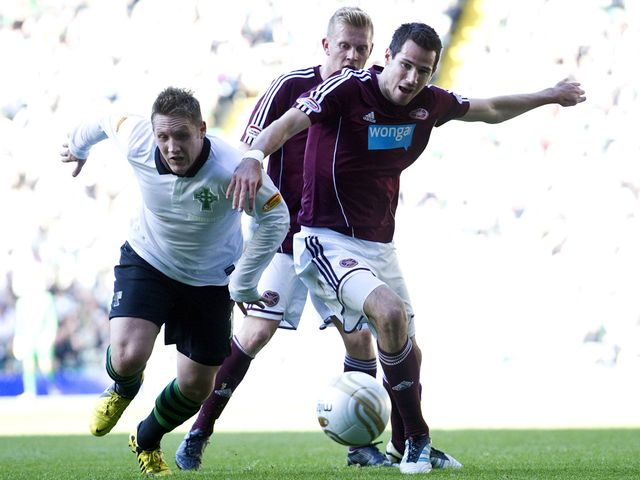 Commons and McGowan battle for the ball.