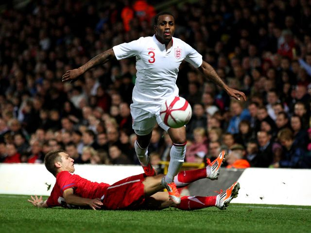 Danny Rose jumps over a challenge.