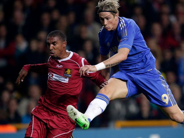 Fernando Torres fires a shot away