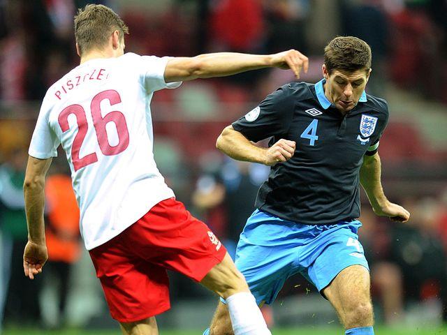 Steven Gerrard takes on Lukasz Piszczek