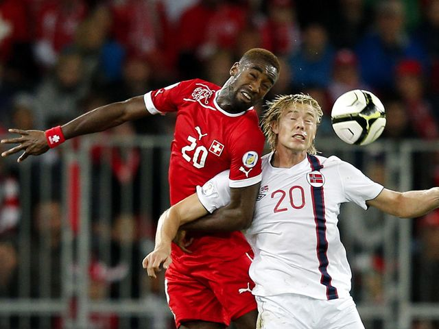Djourou and Soderlund go up for a header.