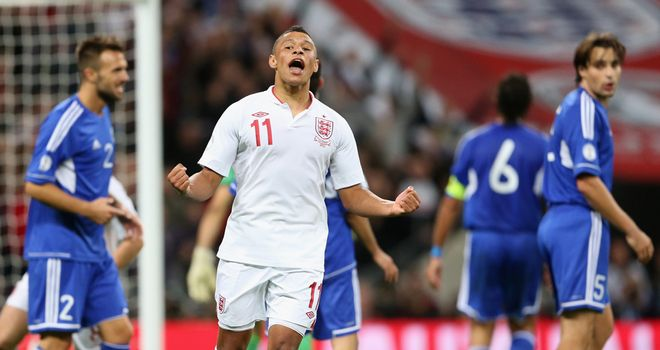 Alex Oxlade-Chamberlain: England winger celebrates his goal against San Marino in October