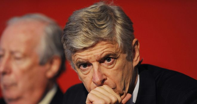 Arsene Wenger: Believes jobs should be given on merit, not colour