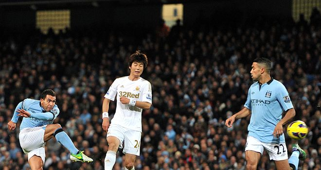 Carlos Tevez: Manchester City's striker proved the difference in a stuttering performance against Swansea