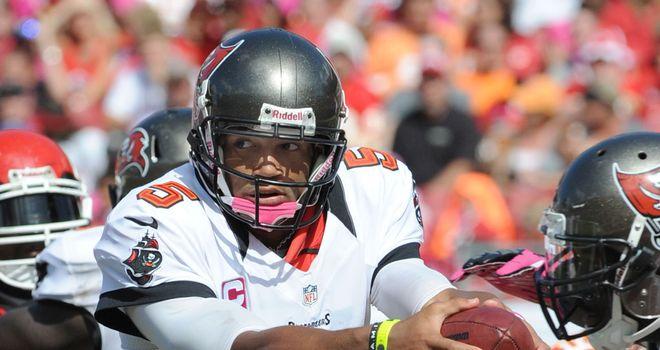 Josh Freeman threw for a season-high 328 yards and three touchdowns
