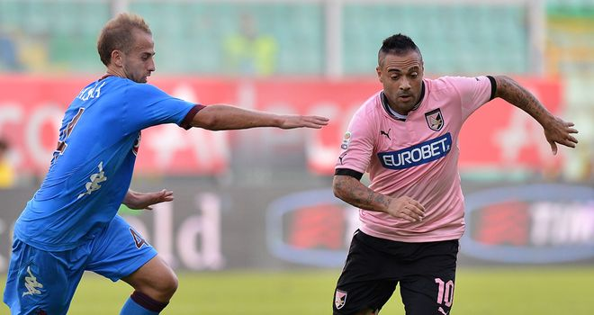 Migjen Basha and Fabrizio Miccoli battle for the ball