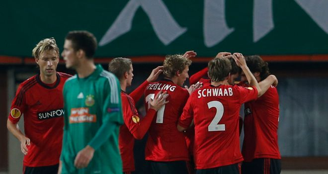Philipp Wollscheid is mobbed after giving Leverkusen the lead