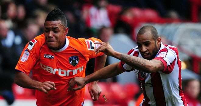 Reece Wabara (left): Spent time on loan at Blackpool last season