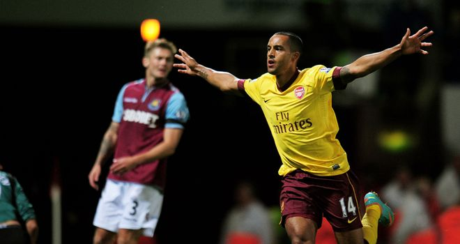 Theo Walcott: Warned by Arsenal chairman Peter Hill-Wood that the club won't break their wage structure to keep him