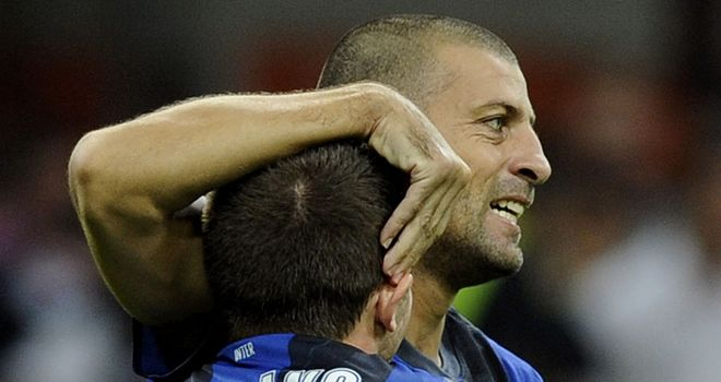 Walter Samuel celebrates his goal with Cassano