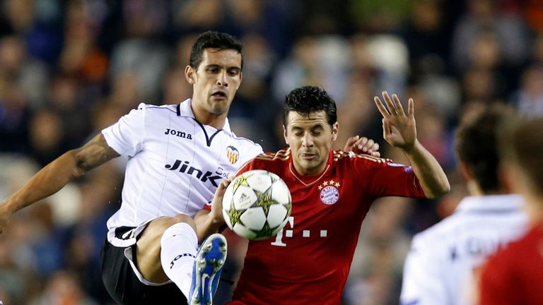 Valencia and Bayern Munich are through after 1-1 draw
