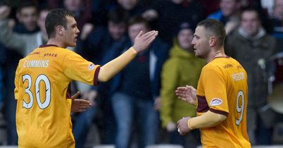 Adam Cummins: Congratulates Michael Higdon (r) after his equaliser