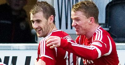 Niall McGinn (left) celebrates his magnificent seventh league goal in succession