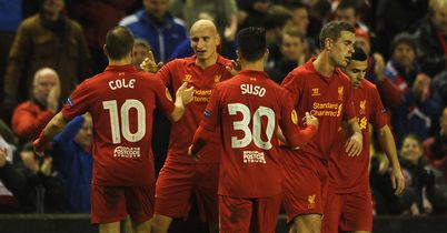 Jonjo Shelvey celebrates his first half opener for Liverpool