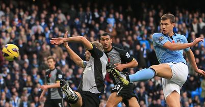 Edin Dzeko strikes late for City