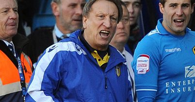 Neil Warnock: Positive about promotion chances